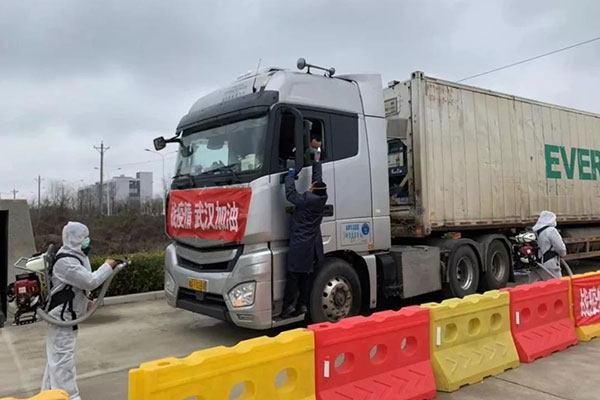 两部委通知:简化应急运输车辆通行证办理 对司机装卸工不实行隔离措施